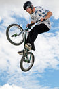 Stunt cyclist swanley uk august an unnamed member of a bmx team gives an aerial display to the public at the red bull pro nats mx Royalty Free Stock Photography