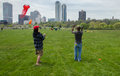 Stunt kites two men flying a pair of at a recent kite festival held in milwaukee wisconsin Royalty Free Stock Photos