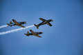 Stunt Pilot Flies Upside Down in Formation Royalty Free Stock Photo