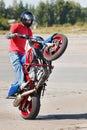 Stunt rider making wheelie