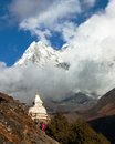 Stupa and Ama Dablam between clouds Royalty Free Stock Photo