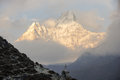 Stupa below great mountain buddhist religious white on the trail to everest base camp Stock Photo