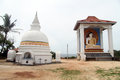 Stupa and buddha seated in monastery in unawatuna sri lanka Royalty Free Stock Photo