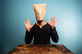 Stupid man with bag over his head and hands up Royalty Free Stock Photo