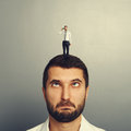 Stupid man with small hopeless man on the head Royalty Free Stock Image