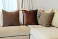 Sturdy brown sofa with brown patterned pillows tweed Royalty Free Stock Photography