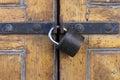 Sturdy padlock on polished wood door Royalty Free Stock Photo
