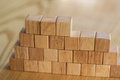 A sturdy wall constructed from wooden blocks symbolizes construction and progress in building from concrete or bricks and creating Royalty Free Stock Photo
