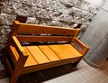 Sturdy wooden bench with arms Royalty Free Stock Photo