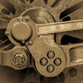 Stwamn train wheel axle and connecting rods of a steam mechanism vintage sepia effect square format Royalty Free Stock Images