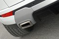 Styl car exhaust pipe for a sporty suv Stock Photography