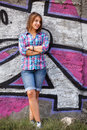 Style teen girl standing near graffiti wall Stock Photography