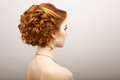 Styling rear view of frizzy red hair woman haircare spa salon concept Royalty Free Stock Photo