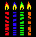 Stylised candles partially hidden behind barrier or striped unusual bright on black Royalty Free Stock Image