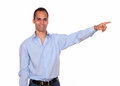 Stylish adult man pointing to his left up portrait of a against white background copyspace Royalty Free Stock Photography