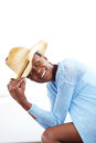 Stylish african woman wearing a cowboy portrait of happy young hat and looking away Royalty Free Stock Photography