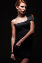 Stylish alluring model in black dress Royalty Free Stock Image