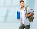 Stylish with backpack young student and folder Royalty Free Stock Image