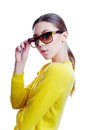 Stylish beautiful woman in sunglasses and yellow sweater isolated on white background Royalty Free Stock Image