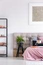 Stylish bedroom with black stool Royalty Free Stock Photo