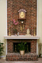 Stylish brick fireplace Royalty Free Stock Photo