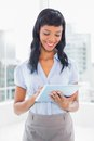 Stylish businesswoman using a tablet pc in office Stock Images