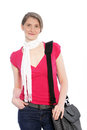 Stylish casual woman with sling bag wearing jeans a red summer top and a decorative neck scarf standing in a relaxed pose her Royalty Free Stock Images