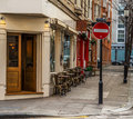 Stylish chairs and tables in front of the restaurant, English st Royalty Free Stock Photo