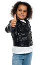 Stylish child savoring sweet success Stock Photos