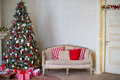 Stylish Christmas interior decorated in white and red colors Royalty Free Stock Photo