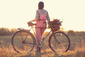 Stylish country girl florist bike Royalty Free Stock Images