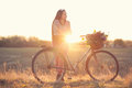 Stylish country girl with vintage bike Stock Image