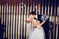 Stylish couple in love the bride and groom are dancing, kissing and cuddling in the modern and stylish interior of the restaurant Royalty Free Stock Photo