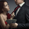 Stylish couples and money Stock Photos
