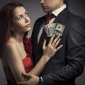 Stylish couples and money Royalty Free Stock Image