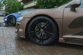 Stylish and expensive sports car closeup. Raindrops on a beautiful brown car.