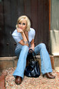 Stylish fashion glamour model posing with jeans and boots button shirt Stock Photos