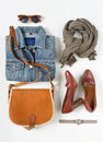 Stylish female clothes set. Woman/girl outfit on white background. Blue denim jacket, gray scarf, vintage crossbag, brown shoes, h