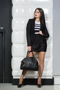 Stylish girl with a bag indoor shop Royalty Free Stock Images
