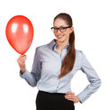 Stylish girl in glasses with red inflated ball Stock Photos