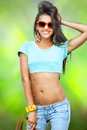 Stylish girl happy young in sunglasses on green background Royalty Free Stock Images