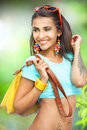 Stylish girl happy young with yellow handbag on green background Stock Photography