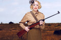 Stylish Girl Scout with Gun at the Field Royalty Free Stock Photo