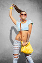 Stylish girl young posing against gray wall Royalty Free Stock Photography