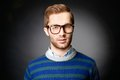 Stylish guy portrait of attractive male in casual clothes and eyeglasses looking at camera Royalty Free Stock Photos