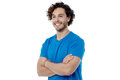 Stylish guy posing confidently cheerful young with folded arms Stock Image