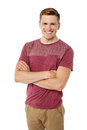 Stylish guy posing over white background cheerful young with folded arms Royalty Free Stock Image