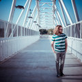 Stylish hipster model with long red hair and beard lifestyle in the street Royalty Free Stock Photography