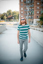 Stylish hipster model with long red hair and beard lifestyle in the street Stock Images
