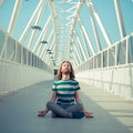 Stylish hipster model with long red hair and beard yoga in the street Royalty Free Stock Images